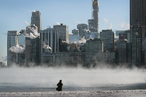 Article thumbnail: Businesses and schools have closed in Chicago more than a thousand flights have been cancelled and mail delivery has been suspended as the city copes with record-setting low temperatures. (Photo by Scott Olson/Getty Images)