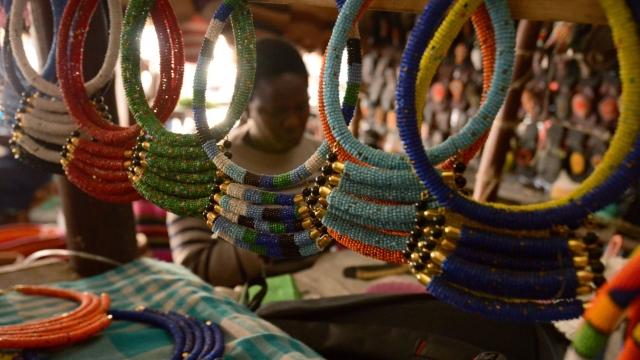 A member of the Kariokor Women Jua Kali Association makes bracelets and necklaces at the open-air Kariokor market in the Kenyan capital Nairobi September 20, 2018. (Photo: SIMON MAINA/AFP/Getty Images)