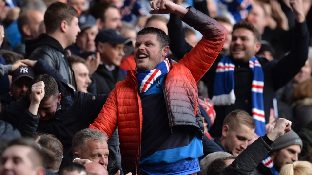 Title race gathers pace: Rangers fans celebrate at the final whistle after Rangers beat Celtic 1-0 at Ibrox in the Scottish Premiership (Getty)