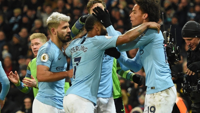 Manchester City celebrate Leroy Sane's winner against Liverpool (Getty Images)