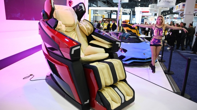 A dancer performs at the Lamborghini massage chair display at CES 2019 consumer electronics show, January 9, 2019 at the Las Vegas Convention Center in Las Vegas, Nevada. - The Bodyfriend LBF-750 Lamborghini massage chair features a 4D massage system, healing massage, brain massage, mood lighting and multi-channel surround sound speakers (Photo by Robyn Beck / AFP) (Photo credit should read ROBYN BECK/AFP/Getty Images)