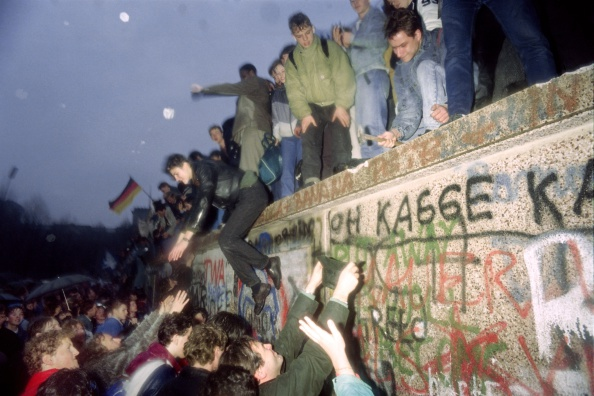People from East Germany greet citizens of West Germany at the Brandenburg Gate in Berlin in 1989. (Photo: Patrick Hertzog/AFP/Getty Images)