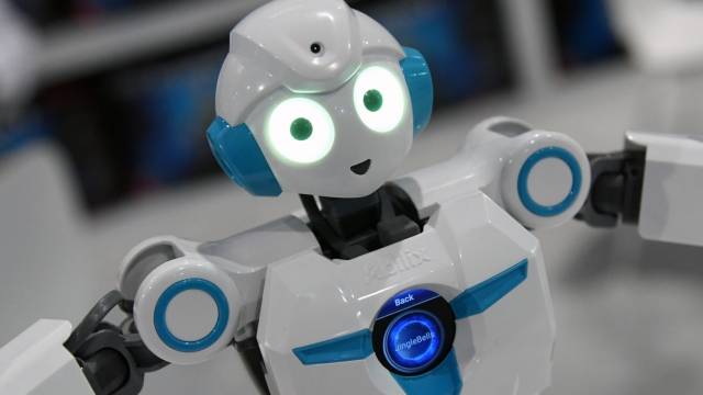 """LAS VEGAS, NV - JANUARY 11: An Everest 4 humanoid series educational robot by Abilix """"dances"""" during CES 2018 at the Las Vegas Convention Center on January 11, 2018 in Las Vegas, Nevada. The USD 699, 36-centimeter tall programmable robot will be available in th U.S. this summer. CES, the world's largest annual consumer technology trade show, runs through January 12 and features about 3,900 exhibitors showing off their latest products and services to more than 170,000 attendees. (Photo by Ethan Miller/Getty Images)"""