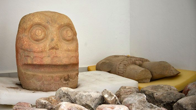One of the skull-like carvings and a stone torso that was discovered (Twitter/National Institute of Anthropology and History)