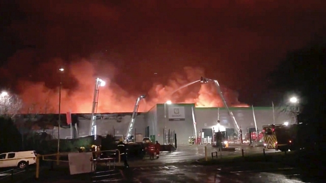 Firefighters work at the scene of the Ocado's flagship robotic distribution centre in flames in Andover, Britain Feburary 6, 2019 in this still picture obtained from a social media video on February 5, 2019. Ringwood Fire Station/via REUTERS