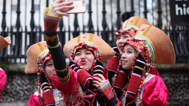 Selfies all round in traditional head gear. (Photo: PA)