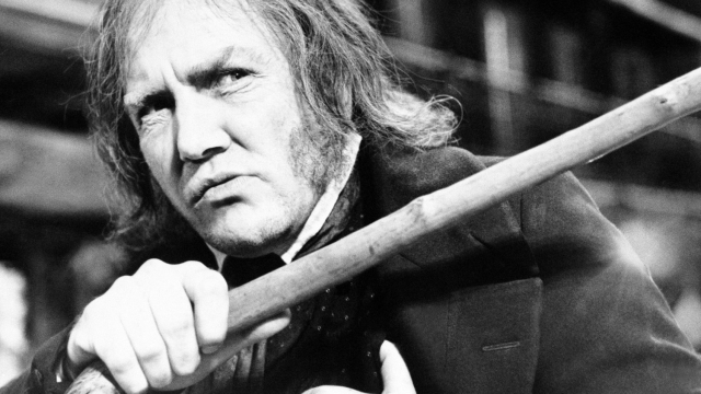Albert Finney waves his cane while playing the title role in ,Scrooge in 1970 (Photo: R. Dear/Ap photo)