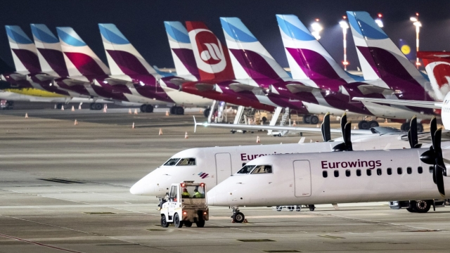 Eurowings aircraft sit on the tarmac of the airport in Duesseldorf, western Germany, Tuesday morning, Nov. 20, 2018 when the Lufthansa daughter was hit by a strike. (Marcel Kusch/dpa via AP)