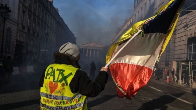 A yellow vest supporter waves the French flag during a 'Day of strikes' on February 5, 2019. (Photo by Alain Jocard/AFP/Getty Images)