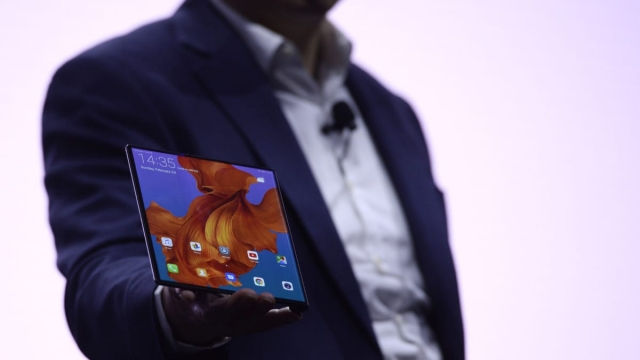Article thumbnail: Richard Yu, the CEO of Huawei's consumer products division presents the new HUAWEI Mate X foldable smartphone at the Mobile World Congress (MWC), on the eve of the world's biggest mobile fair, on February 24, 2019 in Barcelona. - Phone makers will focus on foldable screens and the introduction of blazing fast 5G wireless networks at the world's biggest mobile fair starting tomorrow in Spain as they try to reverse a decline in sales of smartphones. (Photo by Josep LAGO / AFP) (Photo credit should read JOSEP LAGO/AFP/Getty Images)
