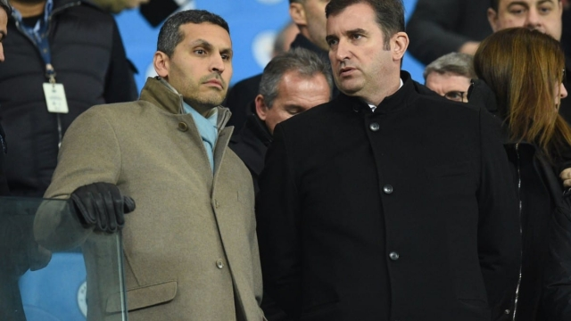 Article thumbnail: Manchester City Emirati chairman Khaldoon al-Mubarak speaks with chief executive Ferran Soriano at the Etihad Stadium on 16 December 2017 (AFP/Getty Images)