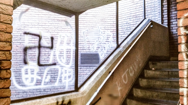"""Antisemitic graffiti in a shopping centre stairwell in London. The words """"fuck Jews"""" and """"BNP"""" are visible alongside swastikas. (Photo: Community Safety Trust)"""