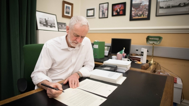Labour leader Jeremy Corbyn signs a letter he has written to Prime Minister Theresa May (Photo: Stefan Rousseau/PA Wire)