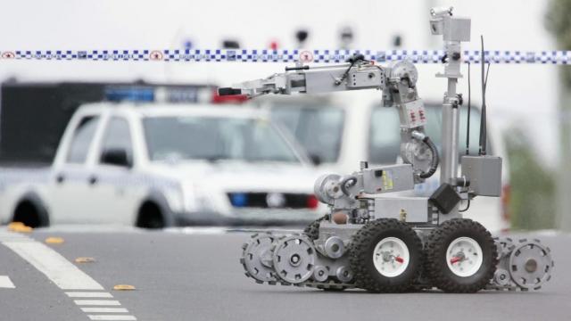 A bomb disposal robot rolls down Wilson Street in Green Valley November 8, 2005 in Sydney, Australia.