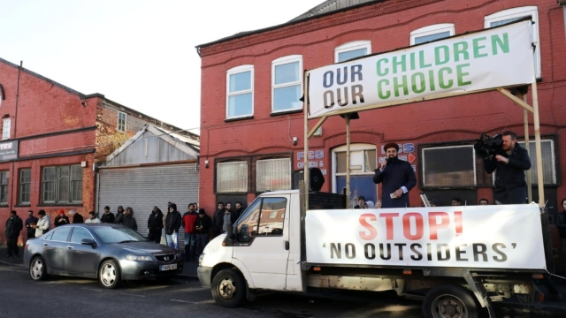 Protesters address the crowd outside Parkfield community school (Photo: SWNS)