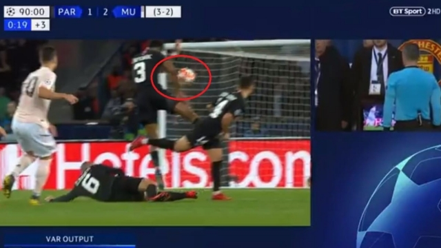 The referee adjudged PSG defender Presnel Kimpembe handled the ball and awarded Manchester United a penalty after consulting VAR (BT Sport)