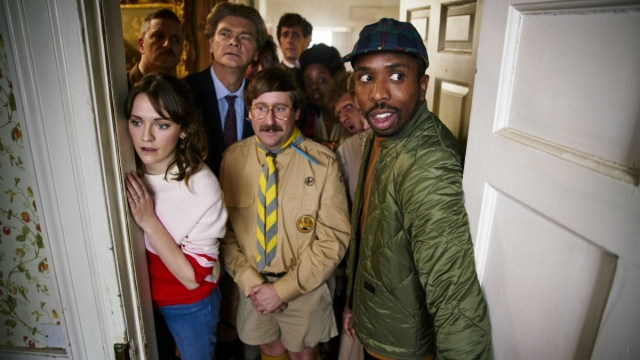 The Captain (BEN WILLBOND), Alison (CHARLOTTE RITCHIE), Julian (SIMON FARNABY), Pat (JIM HOWICK), Thomas Thorne (MAT BAYNTON), Kitty (LOLLY ADEFOPE), Robin the Caveman (LARRY RICKARD), Mike (KIELL SMITH-BYNOE) - (Photo: Button Hall Productions)