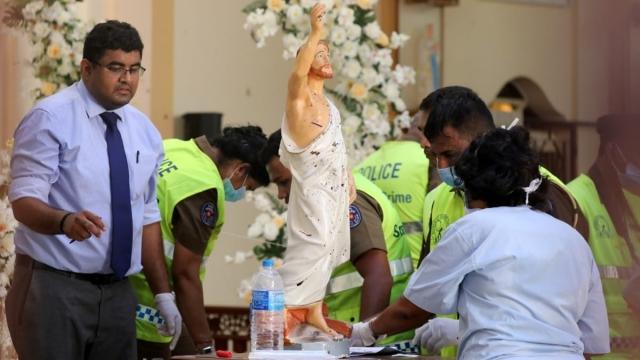 Police officers work at St. Sebastian Catholic Church (Photo: Athit Perawongmetha/Reuters)