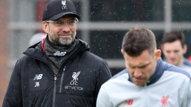 Jurgen Klopp leads his players out for Liverpool's open training session at Melwood on Tuesday (Getty Images)