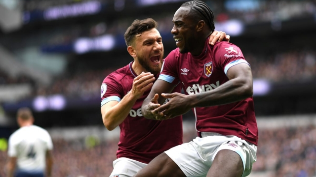 Michail Antonio (R) and Robert Snodgrass (L) celebrate West Ham's winning goal