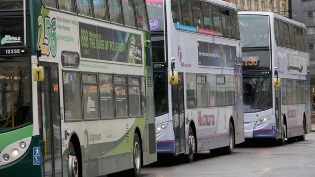 Buses queue up for passengers on the streets of Manchester. (Photo by Christopher Furlong/Getty Images)