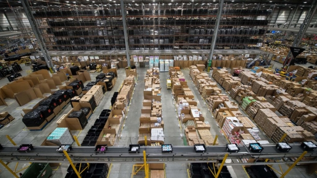 Workers prepare customer orders for dispatch inside an Amazon fulfillment centre in Peterborough (Photo: Getty)