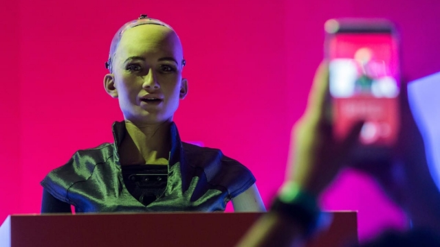 'Sophia the Robot' is seen on stage before a discussion by Hanson Robotics about Sophia's multiple intelligences and artificial intelligence (AI) at the RISE Technology Conference in Hong Kong on July 10, 2018. (Photo by ISAAC LAWRENCE / AFP) (Photo credit should read ISAAC LAWRENCE/AFP/Getty Images)