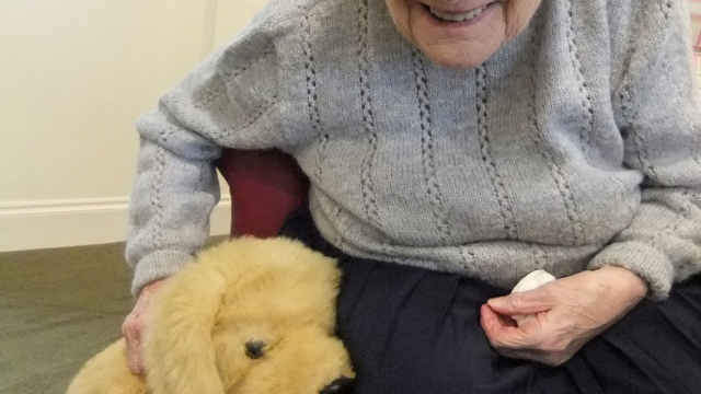 A care home resident with her robopet (Photo: University of Exeter)