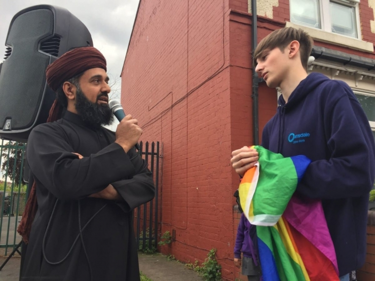 LGBT activist Edan Powell (right) debating with protester Zafar Majid, who had been campaigning against relationship education at Anderton Park school in Birmingham in 2019 (Photo: Richard Vernalls/PA Wire)
