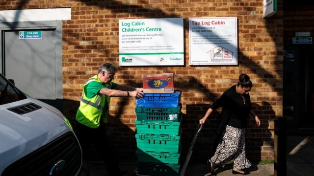 Article thumbnail: Volunteer and trustee of food-waste charity The Felix Project John Richardson delivers surplus food collected from supermarkets to a children's centre on February 27, 2019 in London, England (Getty Images)