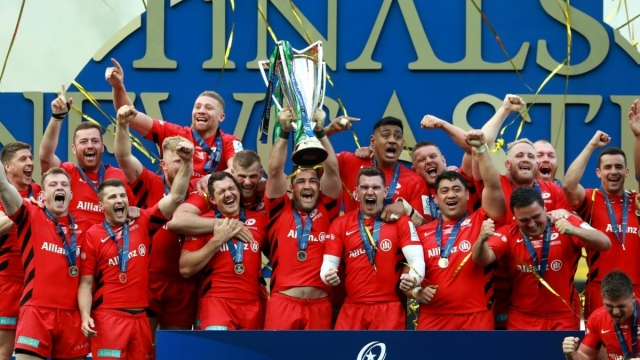 Brad Barritt of Saracens lifts the Champions Cup Trophy following his side's victory over Leinster (Getty Images)