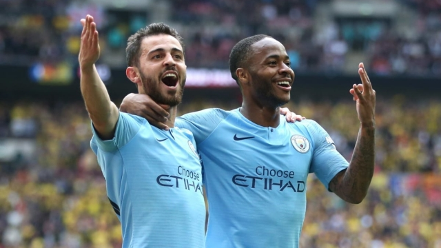 Raheem Sterling of Manchester City celebrates after scoring his team's fifth goal with teammate Bernardo Silva on 18 May 2019 (Getty Images)