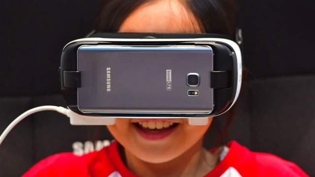 A girl experiences Samsung Electronics' Gear VR at its showroom in Seoul on July 7, 2016. Samsung Electronics on July 7 flagged its biggest operating profit in more than two years, boosted by cost-cutting efforts and solid sales of its latest flagship smartphone. / AFP / JUNG YEON-JE (Photo credit should read JUNG YEON-JE/AFP/Getty Images)
