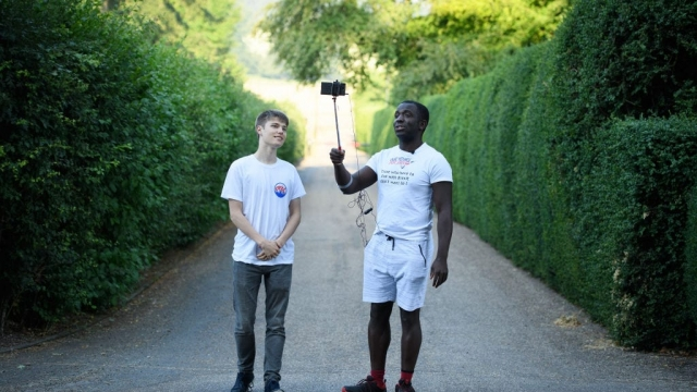 Femi Oluwole records a video during a demonstration at Chequers on July 6, 2018 (Getty)
