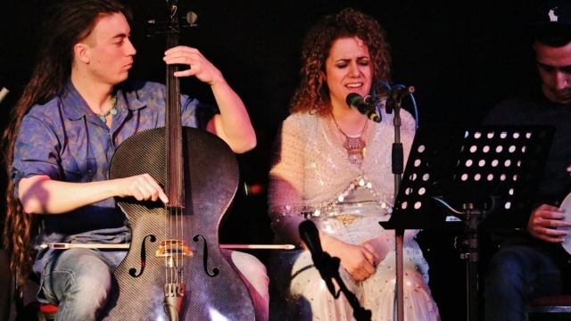 Midya Hijan (right) sings and plays Kurdish tanbur in the band (Photo: Musicians in Exile)