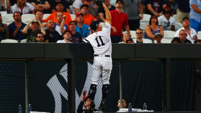 Article thumbnail: Brett Gardner of the New York Yankees stretches to try to make a failed catch (Getty Images)