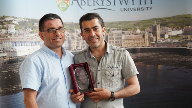 Syrian refugee, Mohammed Karkoubi (right) and Aberystwyth University's Sion Meredith, Head of Learn Welsh (Photo: Vince Jones/Aberystwyth University/PA Wire)