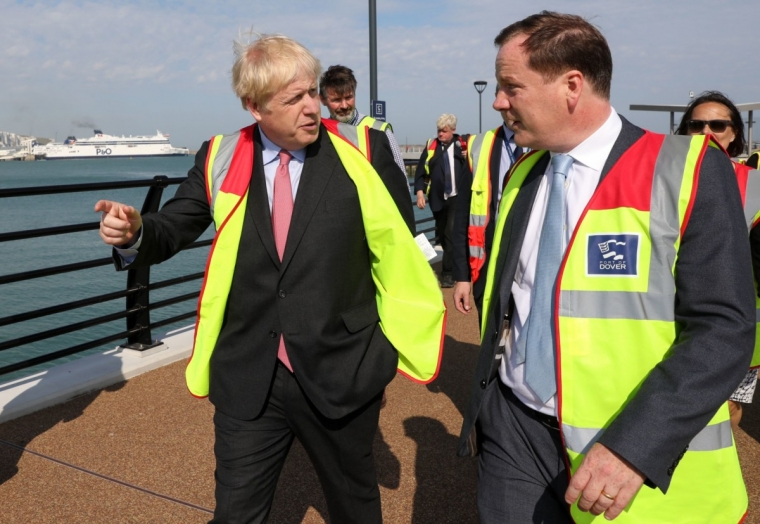 Boris Johnson speaks Charlie Elphicke during a visit to the Port of Dover as part of his campaign trail (Photo: Getty Images)