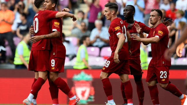 Liverpool players celebrate Roberto Firmino's goal against Lyon