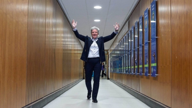 DUP's Alison Bennington walks down a corridor