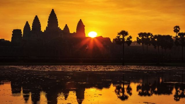 Article thumbnail: The towers of Angkor Wat at sunrise Cambodia Sacred Wonders BBC Two