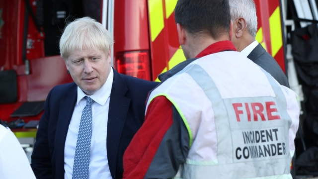 Boris Johnson meets emergency crews on his visit to Whaley Bridge (Photo: Yui Mok/Pool/Reuters)