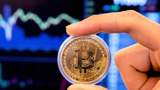 Otherwise known as tokens, cryptocurrencies are alluring because they are independent of Central Bank. (PHOTO: AFP /Jack Guezjack/Getty Images)