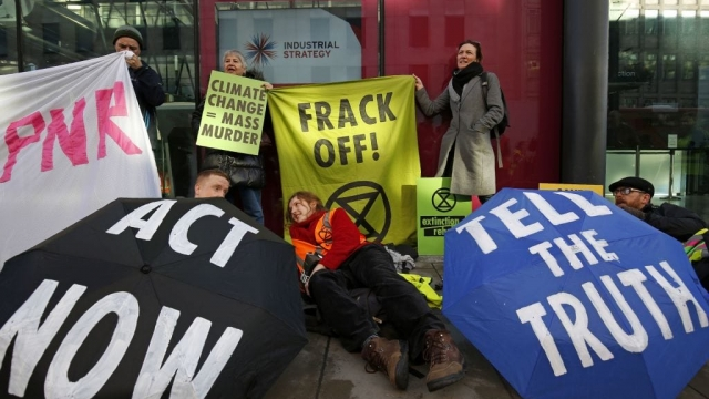 Anti-fracking protesters hold a demonstration outside Department for Business, Energy and Industrial Strategy in central London in 2018. (Photo: Adrian Dennis/AFP/Getty Images)