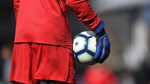Alisson prepares to take a goal kick for Liverpool