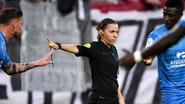 French referee Stephanie Frappart gestures during the French L2 football match between Valenciennes and Beziers