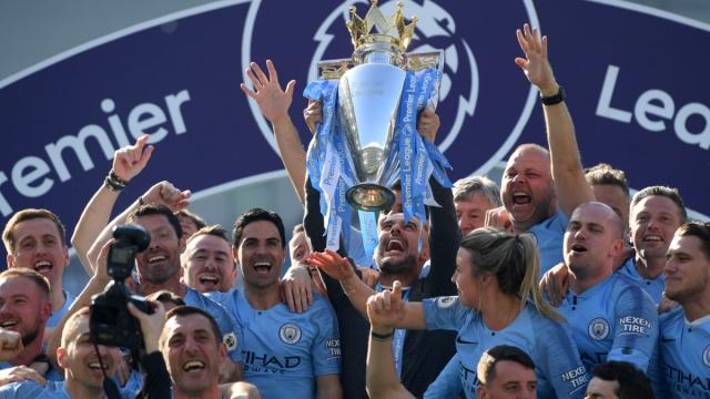 Manchester City celebrate winning the Premier League last season