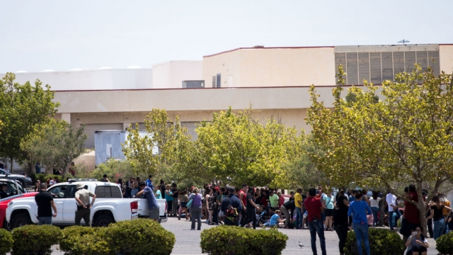 Police evacuating members of the public from the El Paso shopping complex yesterday. (Getty)