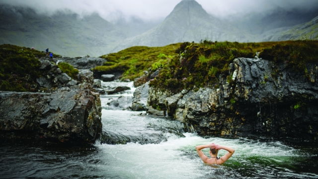Swimming in the Fairy Pools on the Isle of Skye (Photo: Jeff J Mitchell/Getty Images)
