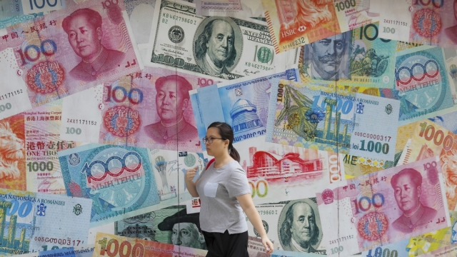 A currency exchange in Hong Kong as the impact of Beijing's trade war with the US was felt